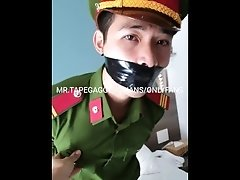 Vietnam police slave in uniform bound and tape gagged